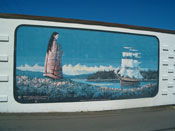 A beautiful mural of a maiden waiting for a ship to return