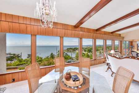 Dining and living room with sweeping ocean views.
