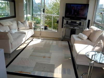 Bright, stylish living room with fabulous views of the Marina at Fisherman's Wharf.