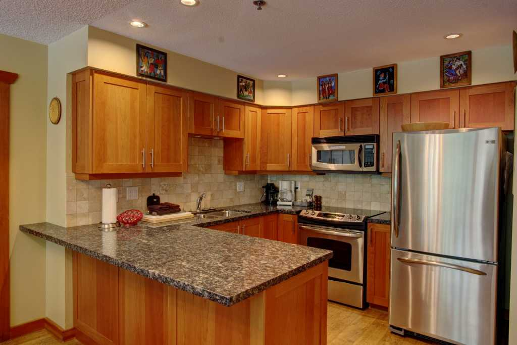 Well-equipped kitchen with granite countertops