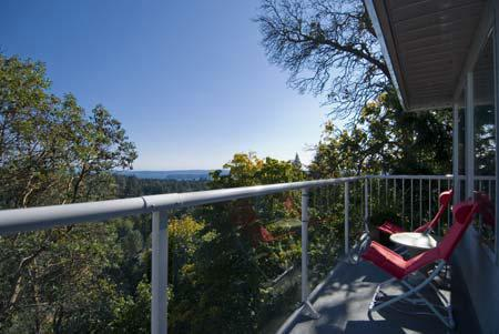 Relax on the balcony with fantastic views of Georgia Strait and the North Gulf Islands.