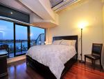 Luxurious bedroom with harbour views.