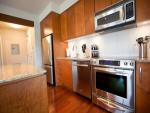 The unit features full kitchen with granite counters, top-quality stainless-steel appliances including refrigerator, range, microwave and super-quiet dishwasher.